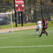 First-year Savina Reid scores a goal against the opposition's lockdown defense.