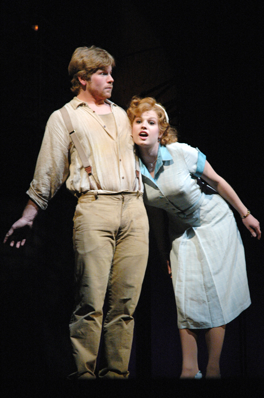 Tim Wilson and Johanna Brickey sing as Bobby and Hope in the 2005 School of Drama performance of Urinetown. Scotch'n'Soda is showing performances of the musical Thursday through Saturday. (credit: Kyle Branigan/Photo Staff)