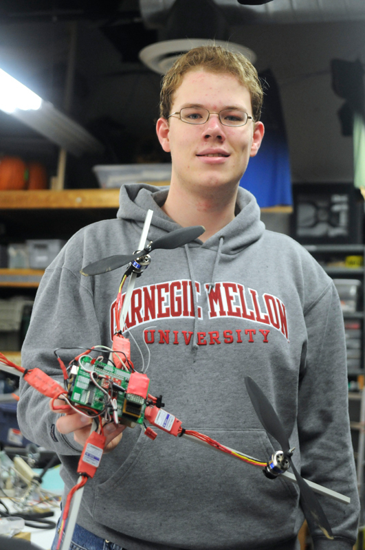 Jacobs' research in robotics involved programming a helicopter to map its environment with the ultimate goal of building a robot capable of navigating environments on its own. (credit: Tommy Hofman/Photo Editor)