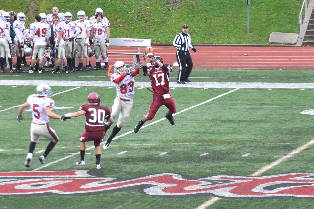 Junior cornerback Sam Thompson (No. 17) pulls down one of his two interceptions on a Dan Burkett pass to senior wide receiver Austin Morman. (credit: Alan Vangpat/ Senior Staff)