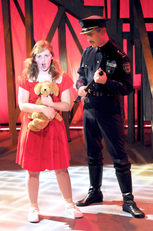 Officer Lockstock (right) serves as the tongue-in-cheek narrator of _Urinetown_. (credit: Courtesy of Guillermo Gomez)