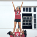 Briana Cook, Alex Reidl, and Sydney Zalewski lift Connie Chan into an elevator, a common cheer stunt.