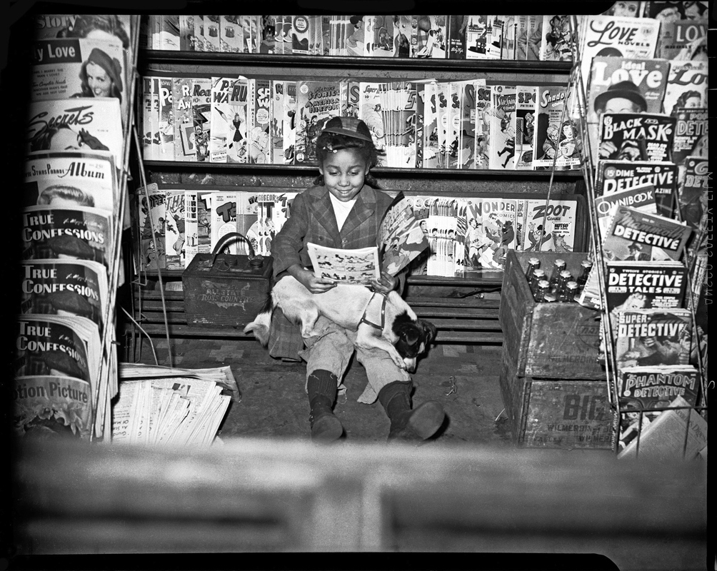 "Teenie Harris photographed a wide variety of subjects, from presidents and celebrities to ordinary citizens. (credit: ""Girl reading comic book in newsstand"" by Charles ""Teenie"" Harris, courtesy of the He)"