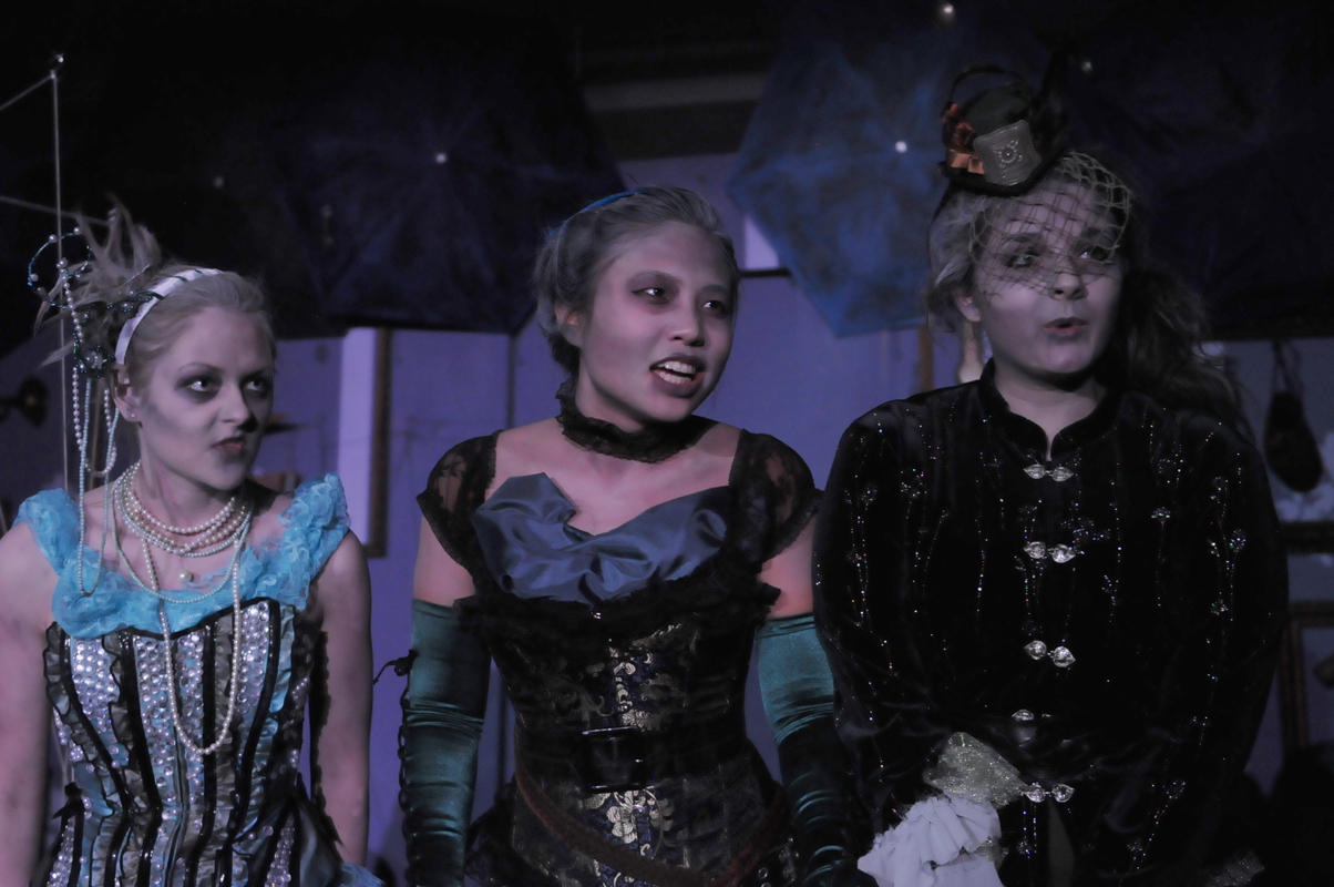 The Stones (played by sophomore Larissa Jantonio, junior Erika Tang, and fourth-year Christine de Carteret, in order of appearance) served as an Underworld version of a Greek chorus. (credit: Courtesy of Guillermo Gomez)