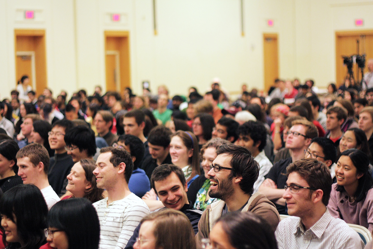 Audience members at the Veritas Forum reacts to a panelist's joke. The forum, held on Saturday night, drew a crowd of several hundred students, faculty, and staff to listen to three Carnegie Mellon professors share their views on how and why we should work. Afterward, audience members broke into discussion groups. (credit: Courtesy of Allison Huang)
