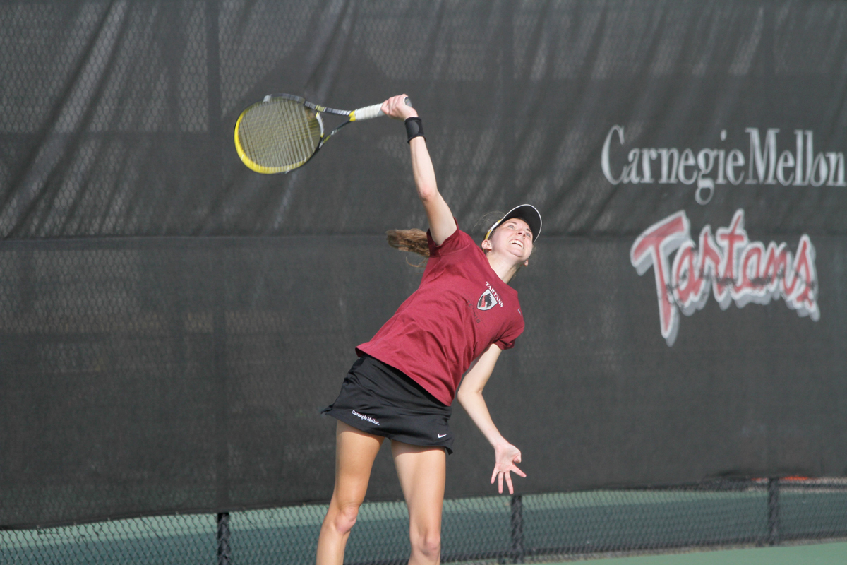 First-year Angela Pratt delivers a serve during her No. 5 singles match against Williams College last Monday. (credit: Jonathan Carreon/Photo Editor)