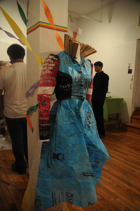 "In her piece ""Trashy Fashion,"" BHA sophomore Janet Lorenz constructed a victorian-inspired dress out of plastic bags, bubble wrap, and a paper bag. (credit: Jennifer Coloma/Operations Manager)"