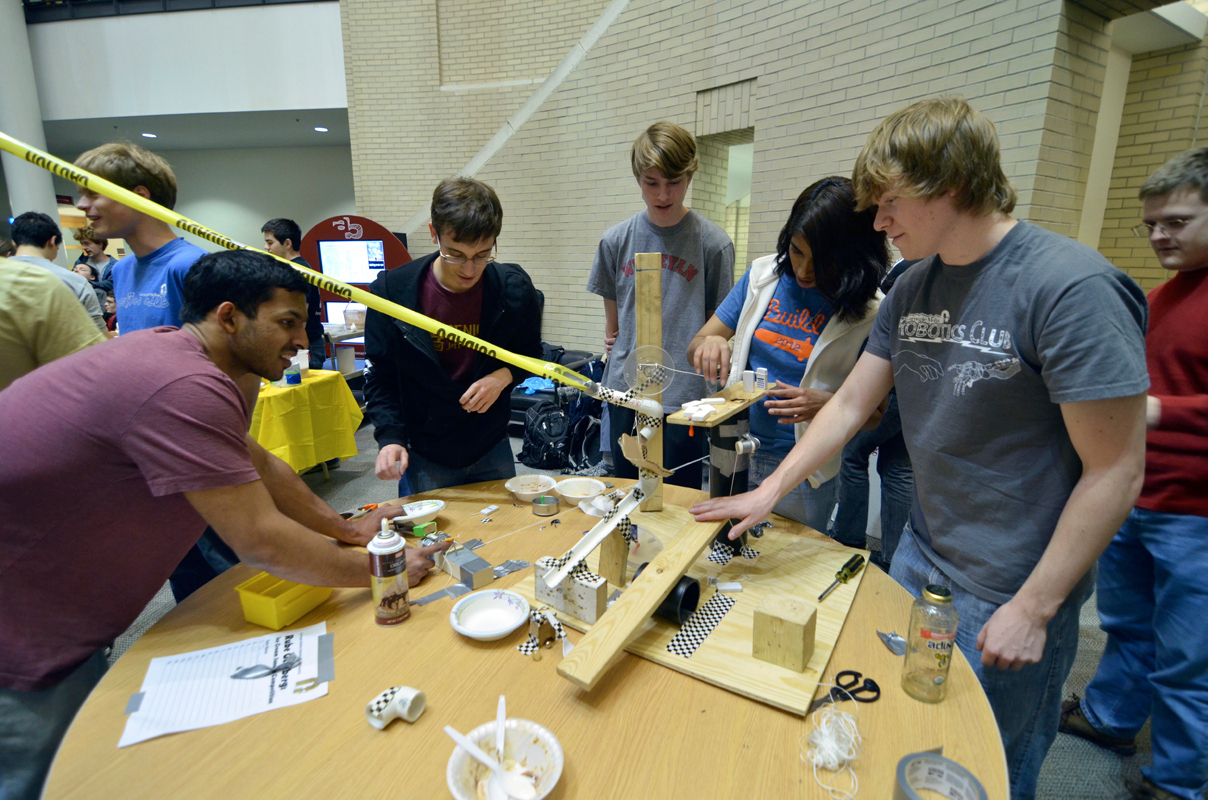 Students gathered in the University Center Friday night to build complex machines that would scoop ice cream and place it into cones. The event was hosted by the Robotics Club. (credit: David Chang/Staff)
