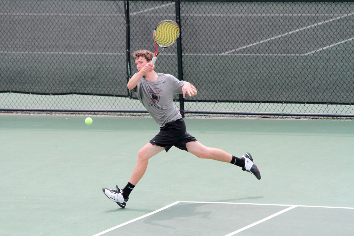 First-year Christian Heaney-Secord wins at No. 2 singles to clinch the match against Denison for the Tartans. (credit: Jonathan Carreon/Photo Editor)