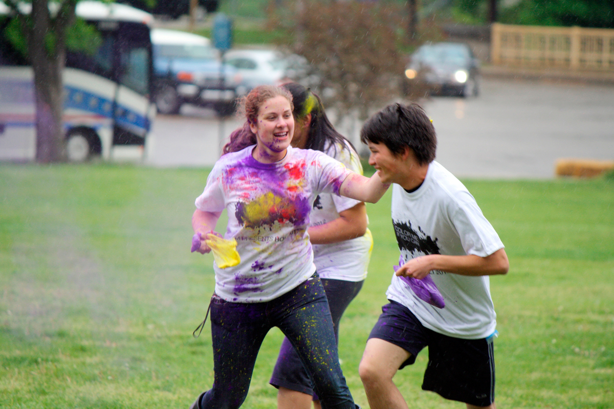 Junior chemistry majors Alessandra  Zimmerman and Dylan Mori tagged each other with colored powder as part of this year's Holi celebration. (credit: Courtesy of Alessandra Zimmerman)