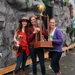Kappa Alpha Theta sisters hold their first place Booth trophy up in front of their booth.