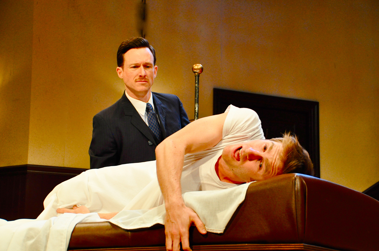 Dr. Givings (played by Brad Heberlee) performs a routine treatment on Leo Irving (played by Carnegie Mellon senior acting major Denver Milord). (credit: Courtesy of Suellen Fitzsimmons)