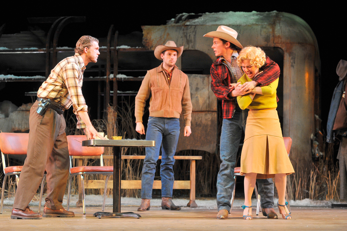 Bo Decker (played by senior acting major Adrian Blake Enscoe) seizes his unwilling fiancé, Cherie (senior  acting major Annie Heise). Meanwhile, Sheriff Will Masters, left (senior acting major Patrick de Ledebur),  and Bo's companion Virgil, second from left (senior acting major Michael Cusimano), strive to keep the peace.  (credit: Courtesy of Louis Stein)