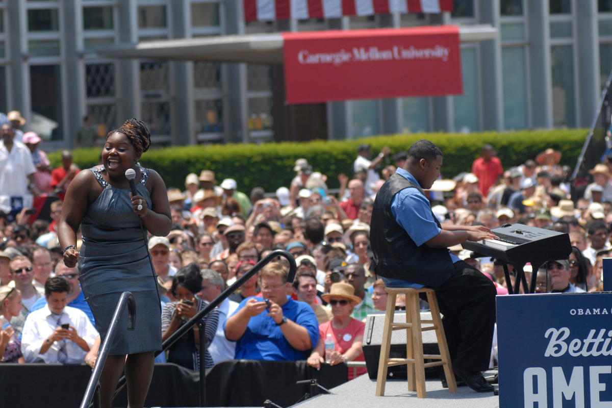 Carnegie Mellon students Sheryl Sesay and Monte Reid perform songs before President Barack Obama's speech on campus Friday afternoon. (credit: Kate Groschner/Photo Staff)