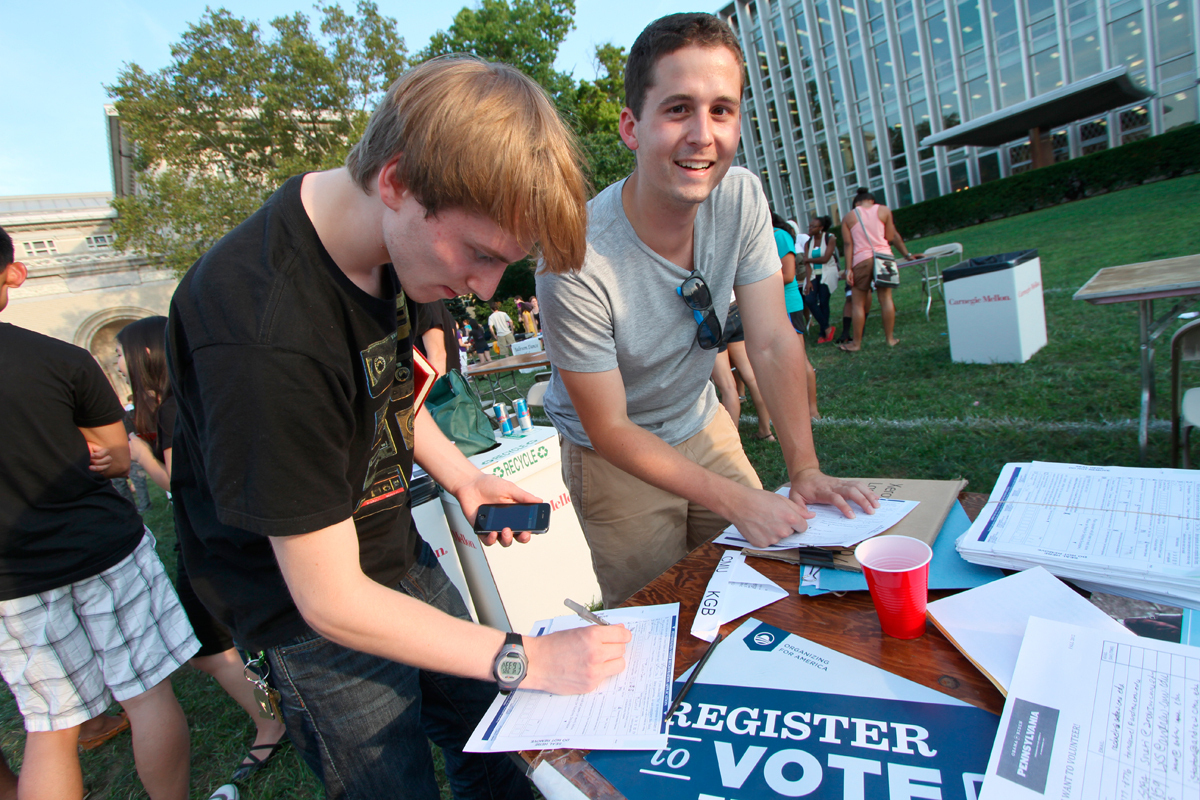 First-year drama student Colin-James Whitney and junior international relations and politics and ethics, history, and public policy double major Daniel Nesbit register to vote. (credit: Jonathan Carreon/Photo Editor)
