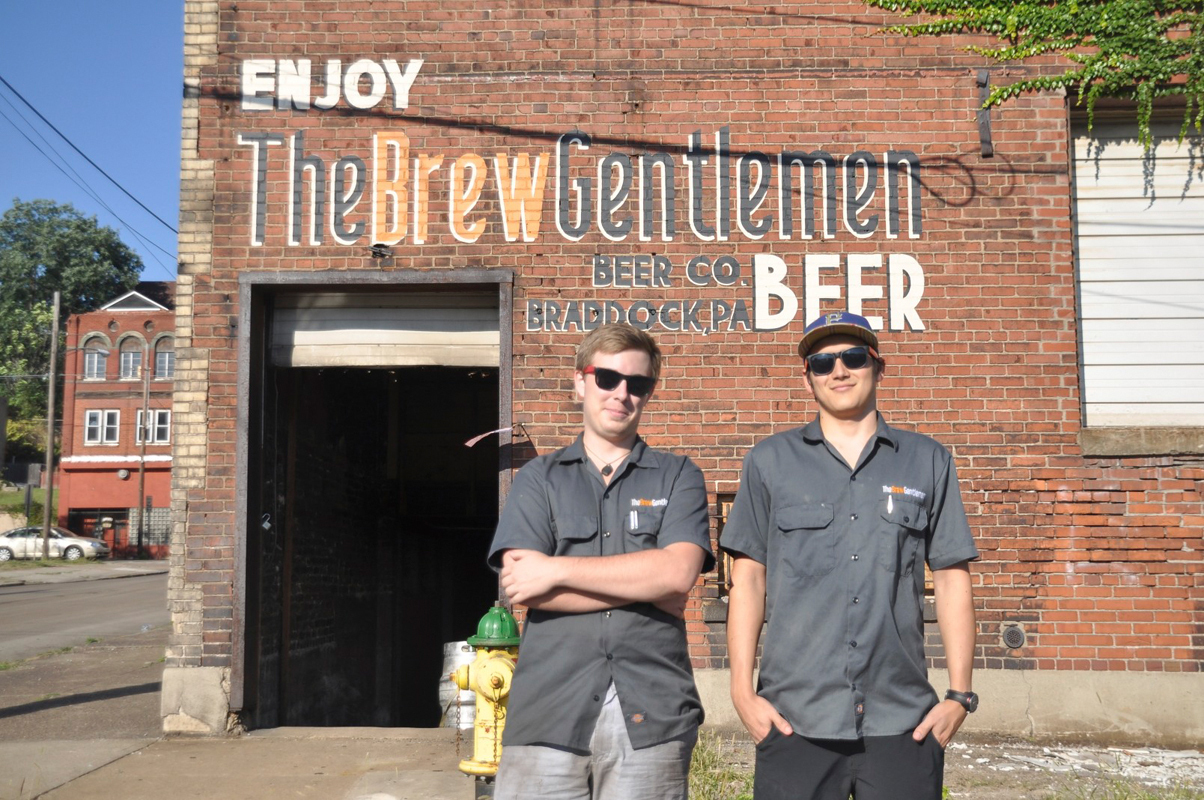 The Brew Gentlemen, Asa Foster (left) and Matt Katase (right), stand in front of their space in Braddock, Pa. (credit: Alan Vangpat/Layout Staff)