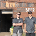 The Brew Gentlemen, Asa Foster (left) and Matt Katase (right), stand in front of their space in Braddock, Pa.