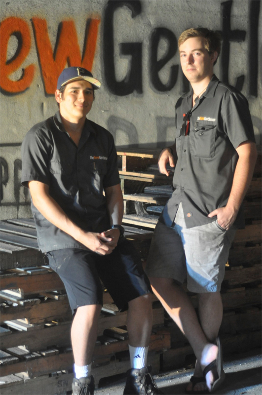 Katase (left) and Foster (right) take a break from brewing. (credit: Alan Vangpat/Layout Staff)