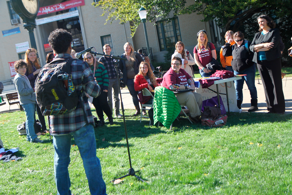 """People gather on the Cut to hear students' coming out stories. ALLIES organized a """"Coming Out at the Fence"""" event for National Coming Out Day last Thursday. October is LGBT History Month. (credit: Jennifer Coloma/Operations Manager)"""