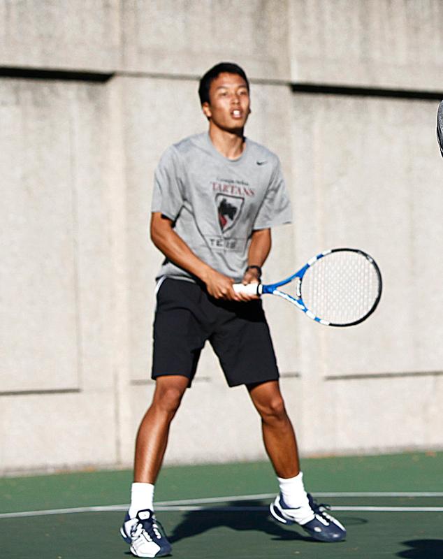 First-year Kosuke Hasegawa clinches the match for the Tartans.  (credit: Jonathan Leung/Junior Photographer)
