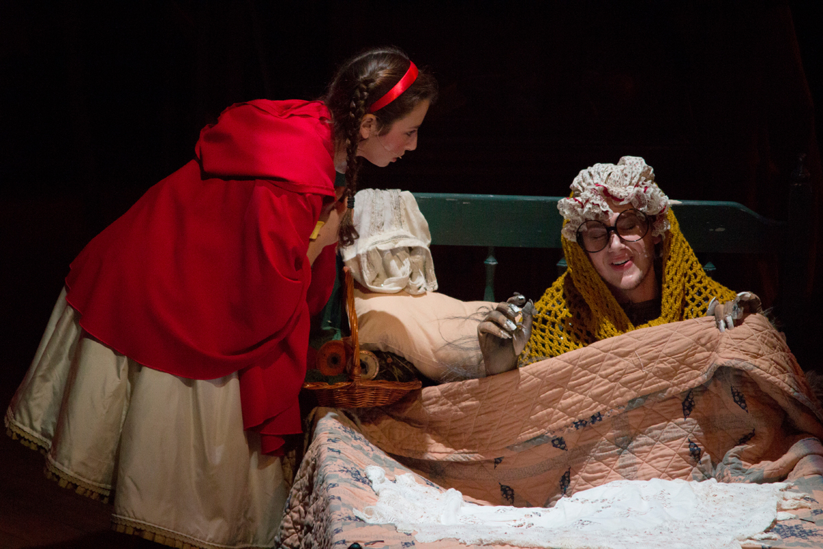 Little Red Riding Hood (junior vocal performance major Hannah Marks) questions her grandmother's strange, wolf-like appearance. (credit: José Lopez/)