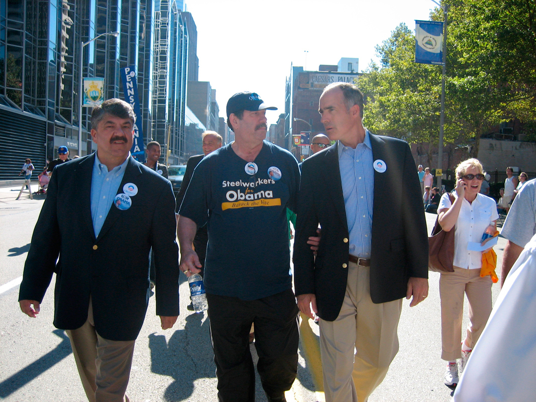 Senator Bob Casey (D-Pa.), right, marches in the Labor Day parade with national AFL-CIO secretary Richard Trumka, left, and United Steel Workers president Leo Gerard, center. (credit: Photo courtesy of aflcio via Flickr)