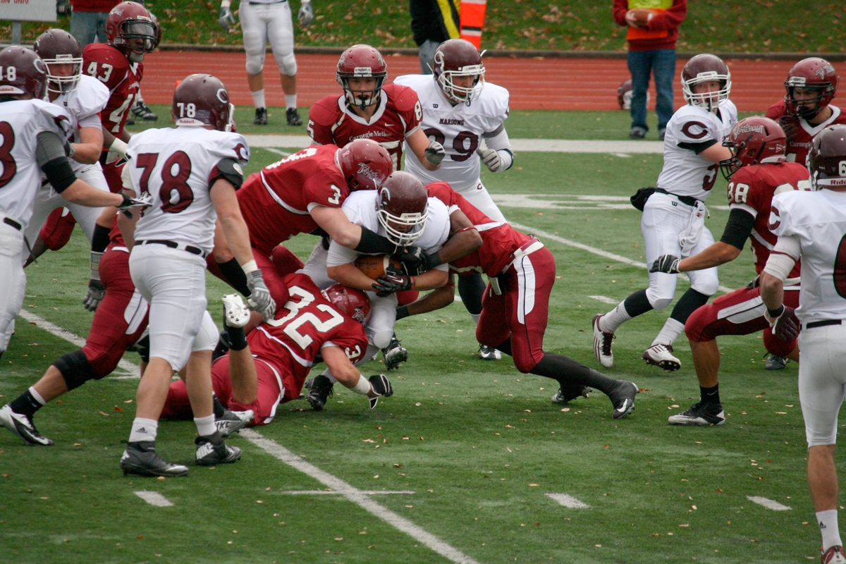 The Tartans displayed their strong defense on Saturday by tackling a University of Chicago player. (credit: Kelsey Scott/Staff Photographer)