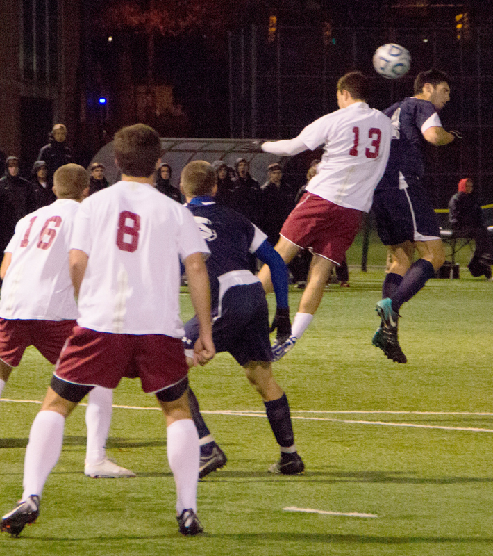 No. 13 sophomore defender Jakob Rohwer jumps to header the ball. (credit: José Lopez/Junior Photographer )