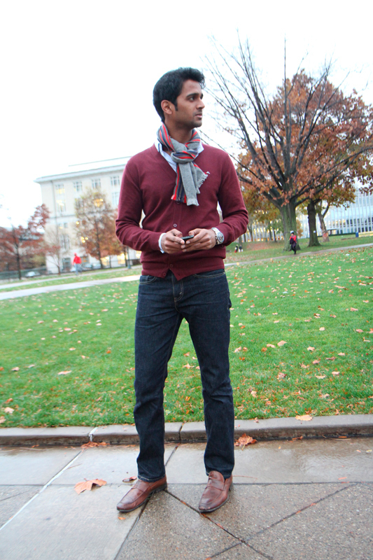 Senior biology major Varun Deshpande pairs an oxblood cardigan with dark jeans and a neutral scarf for a laid-back, preppy look. (credit: Jonathan Carreon/Photo Editor)