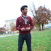 Senior biology major Varun Deshpande pairs an oxblood cardigan with dark jeans and a neutral scarf for a laid-back, preppy look.