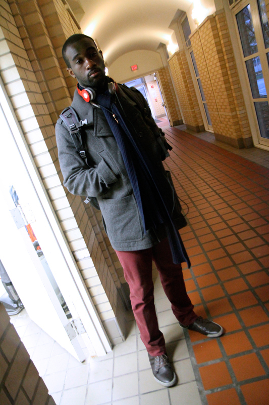 Senior business administration major Ugonna Osuala pairs burgundy pants with a gray coat for an edgier look. (credit: Jonathan Carreon/Photo Editor)