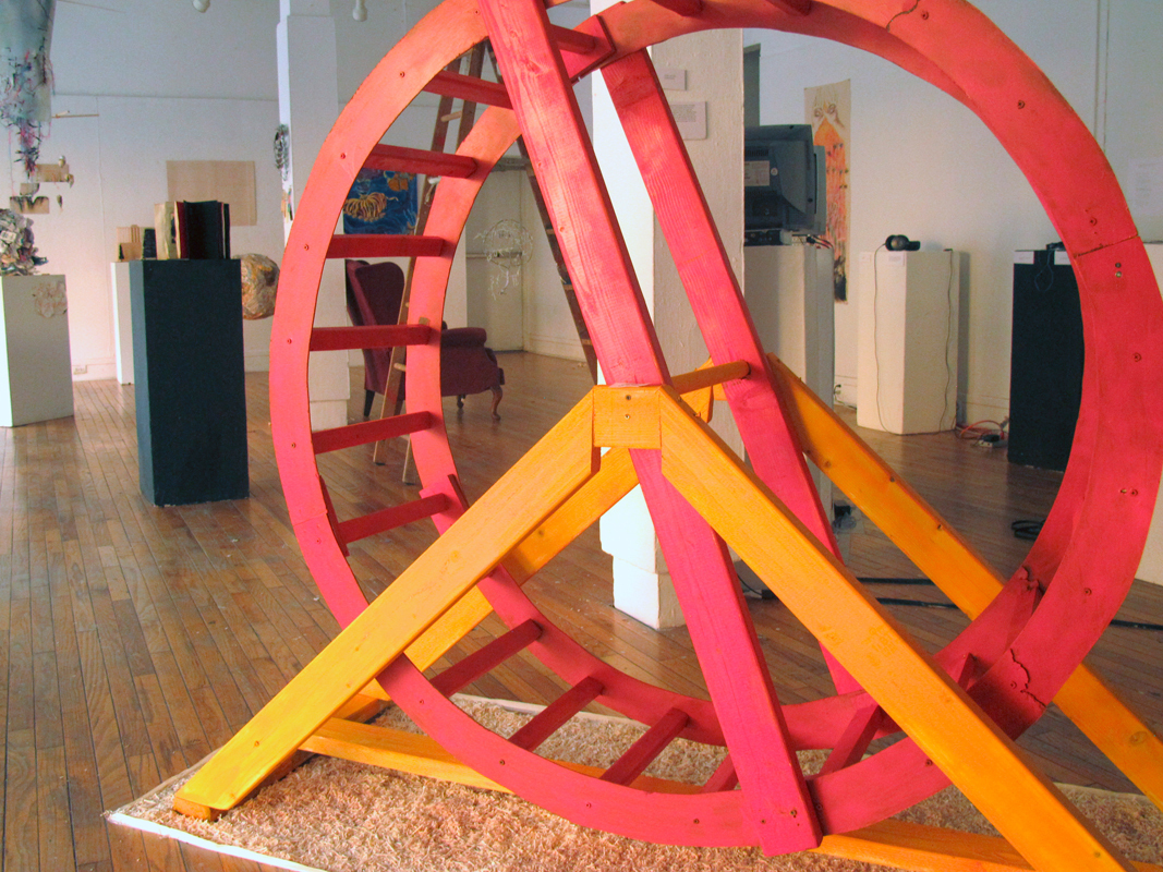 A giant, brightly colored hamster wheel is among the innovations of first-year students in the School of Art currently on display at The Frame Gallery. (credit: Braden Kelner/)
