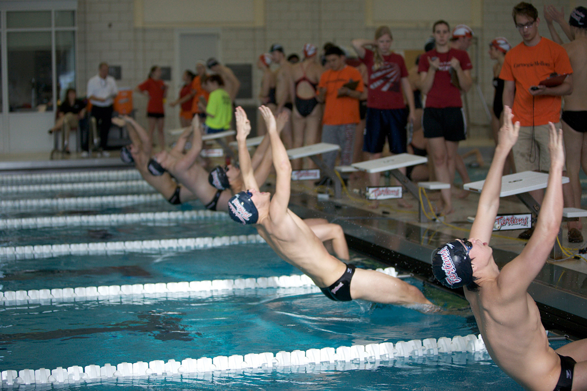 The Tartans push off from the blocks to begin the backstroke event. (credit: Jonathan Leung/)