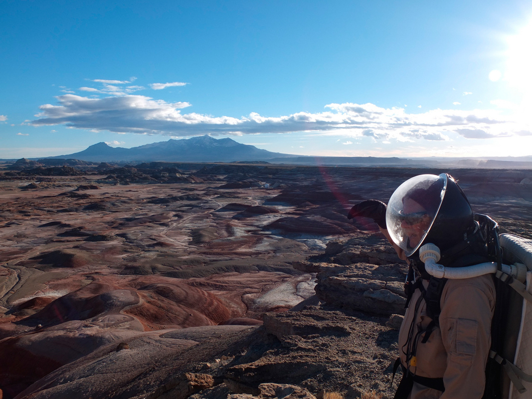 Team members explore the psuedo-Martian landscape in spacesuits. (credit: Courtesy of Dan Wilcox via Flickr)