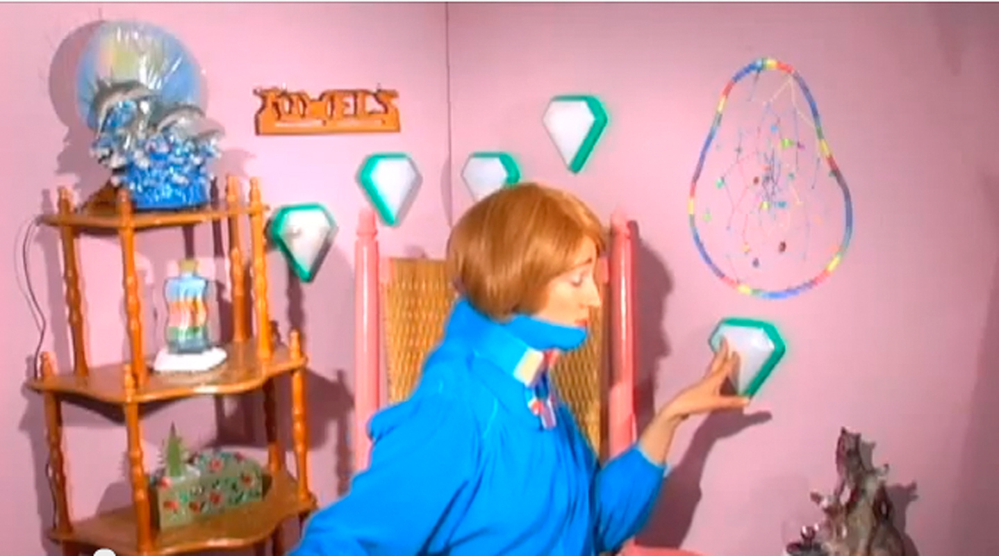 "Artist Shana Moulton's video installation piece ""Whispering Pines 3"" portrays fictional persona Cynthia in her technicolor environment. (credit: Screenshot courtesy of youtube.com)"