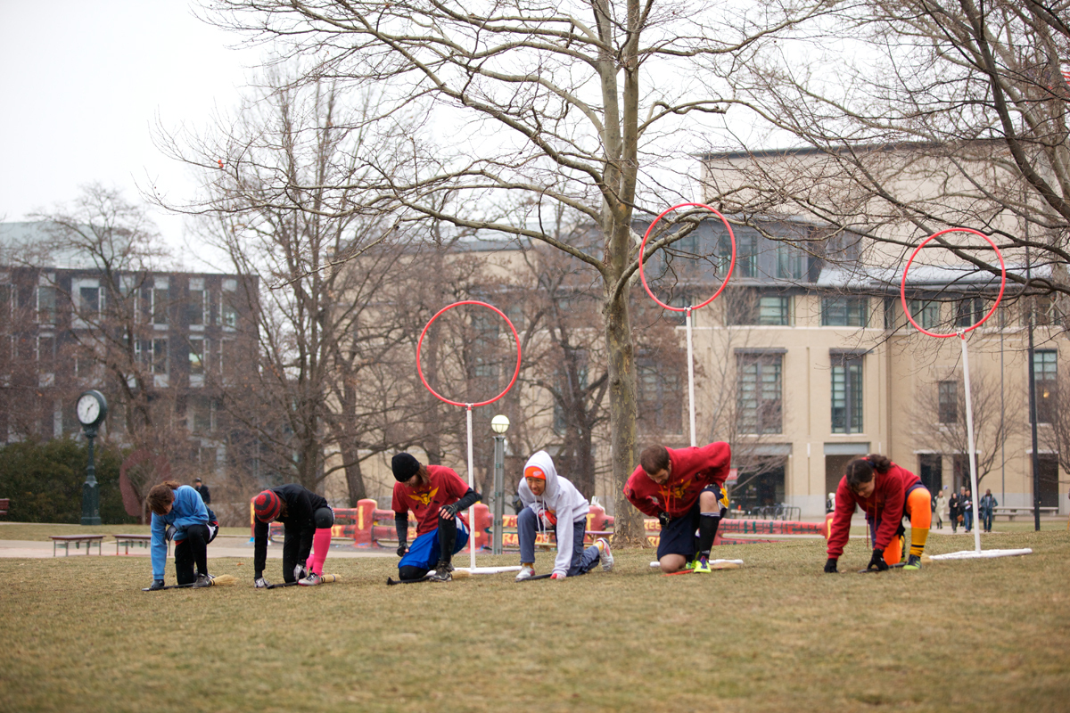 Members of the CMU Marauders, Carnegie Mellon's Quidditch team, prepare for the start of a weekday practice on the Cut. (credit: Jonathan Leung/Assistant Photo Editor)