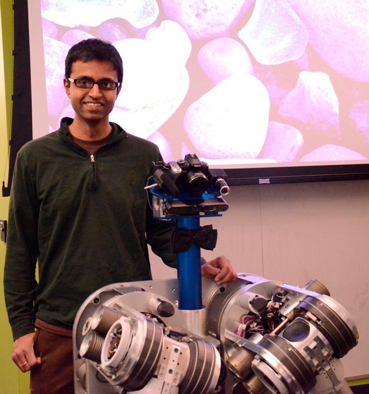 "Siddharta Srinivasa poses with HERB, his ""labor of love."" (credit: Kate Groschner/Photo Editor)"