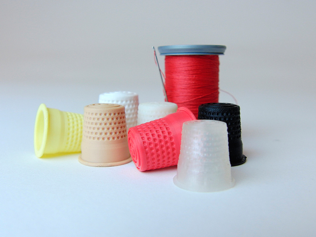 3-D printing can produce a variety of objects from plastic, such as these thimbles. (credit: Courtesy of Creative Tools via Flickr)