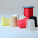 3-D printing can produce a variety of objects from plastic, such as these thimbles.
