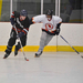 A Carnegie Mellon player maneuvers the puck away from a La Roche College defender during a game at the Island Sports Center.