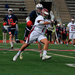 Senior midfielder James Komianos (No. 1) fights for position during Saturday's game in Gesling Stadium  against the University of Dayton. The matchup was the team's second to last of the season.