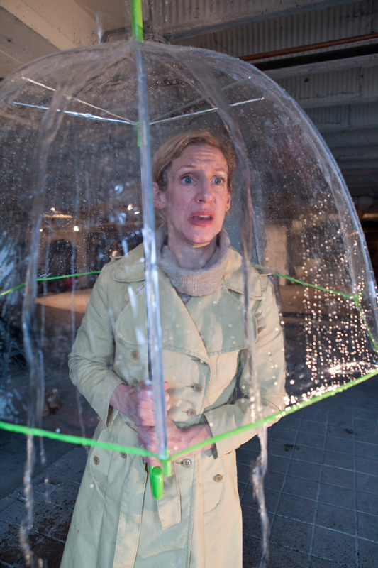 Gry, Man's ex-wife and the only named character in the play, is always portrayed in the rain. (credit: Photo courtesy of Heather Mull)