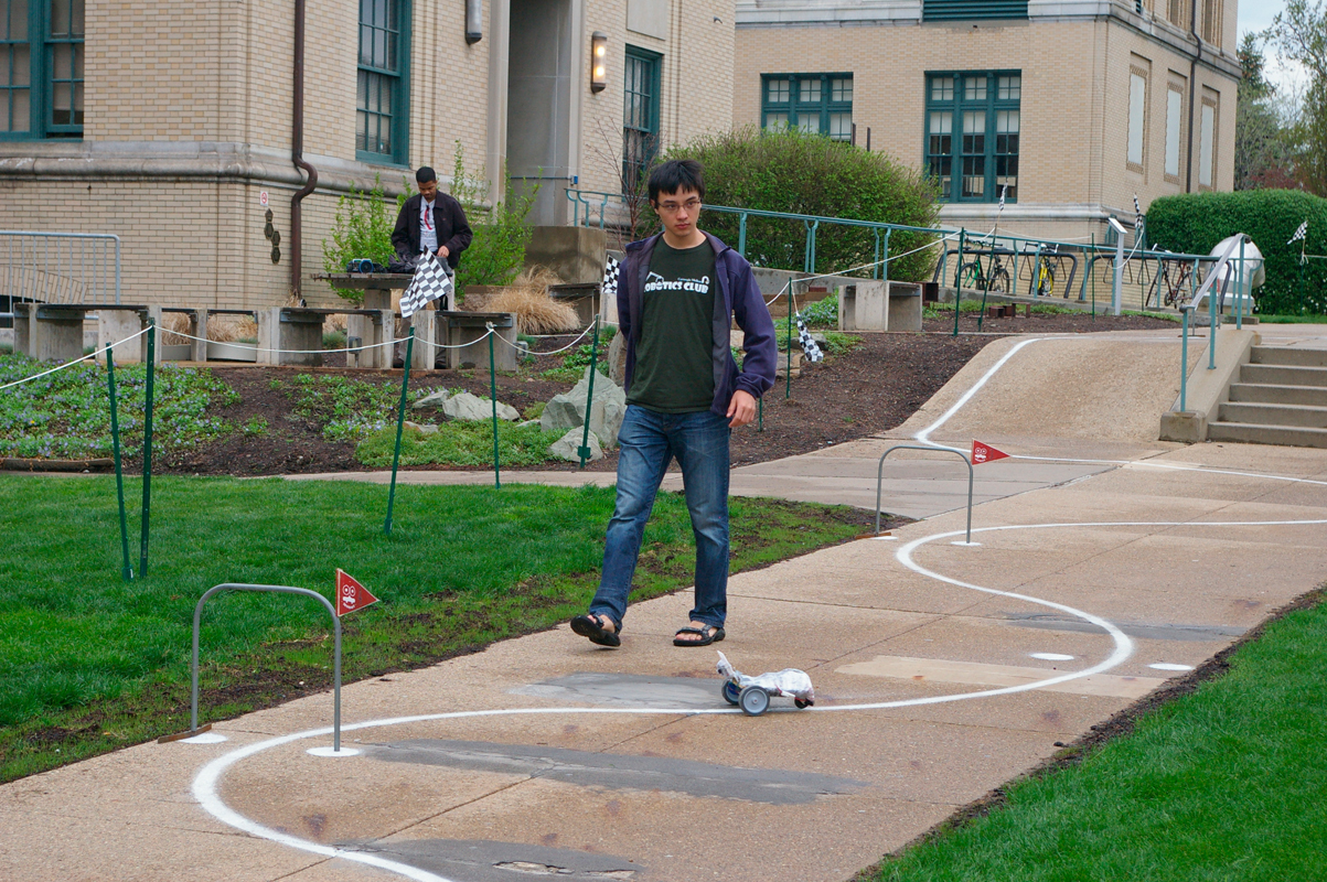 First-year mechanical engineering major Sam Zeng of MoBoss watches his mobot travel down the course. (credit: Greg Hanneman/Contributing Editor)