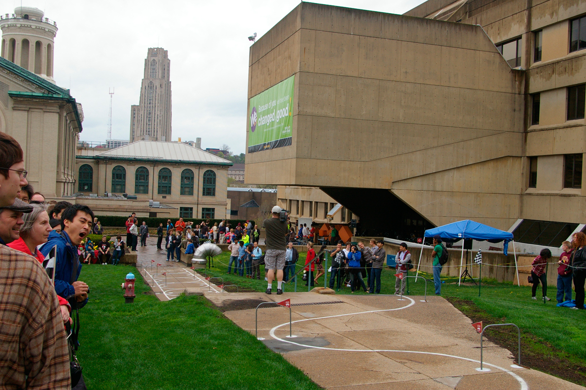 A large crowd showed up in front of Wean Hall to watch mobile robots travel down the slalom course.  (credit: Greg Hanneman/Contributing Editor)