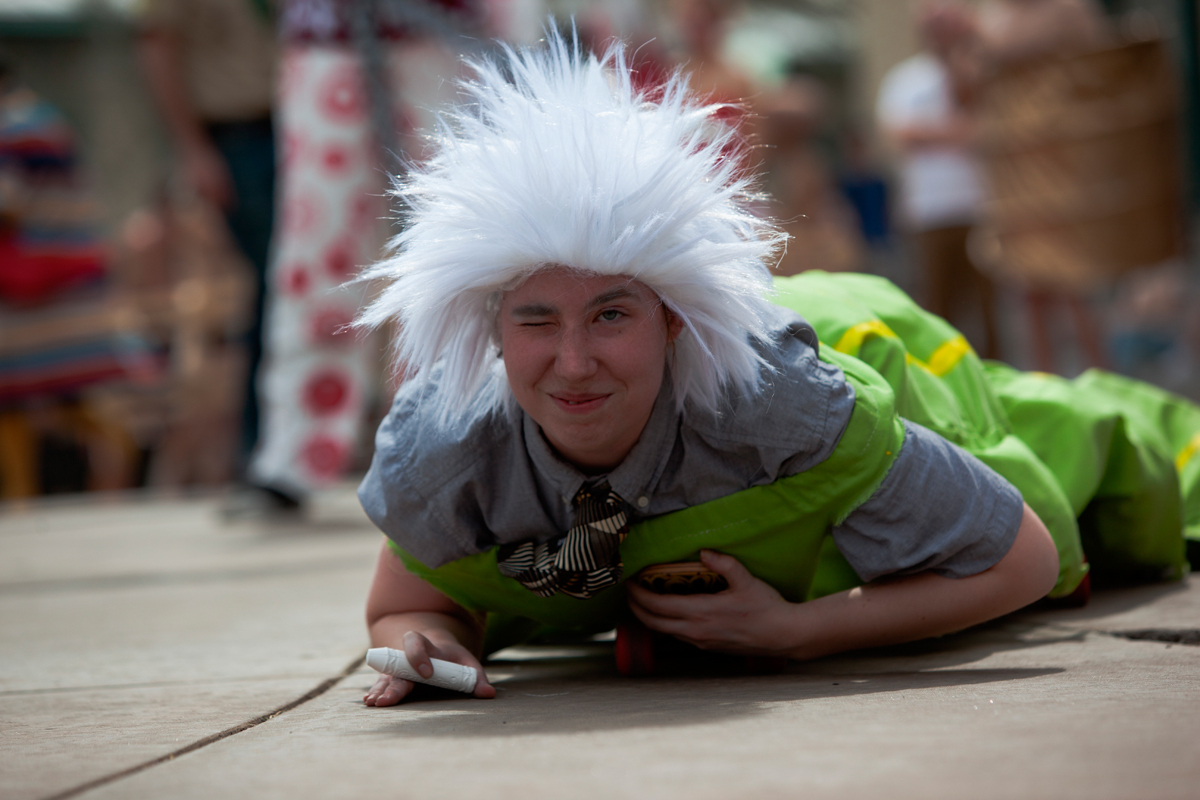 A student crawls down the incline in a worm costume. (credit: Jonathan Leung/Assistant Photo Editor)