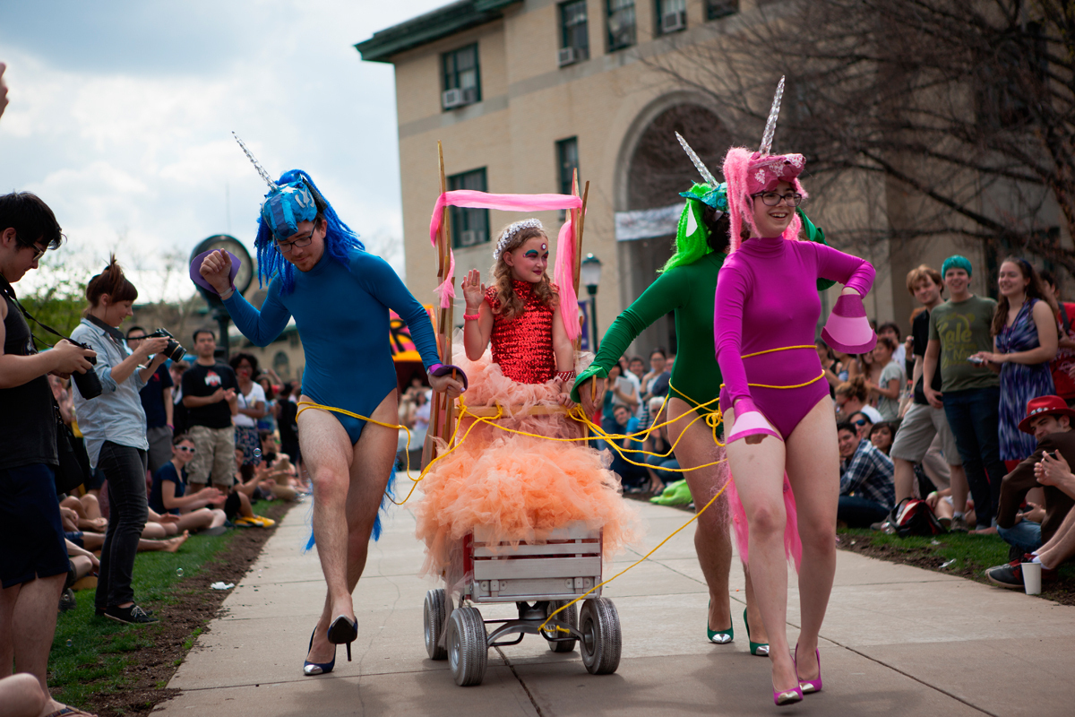 Three students dressed as unicorns in heels escort a princess down the incline. (credit: Jonathan Leung/Assistant Photo Editor)