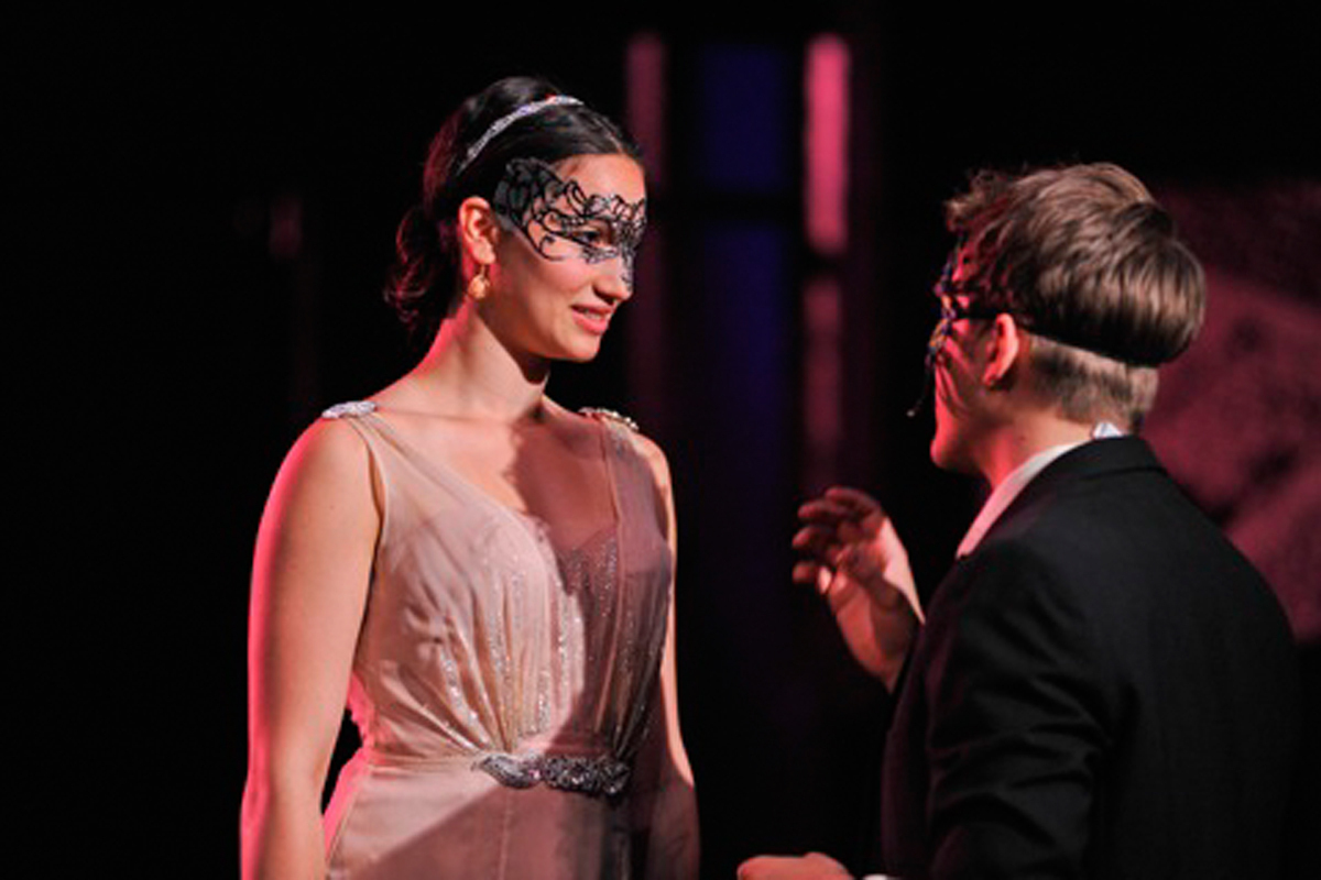 Romeo, played by senior acting major Adam Hagenbuch, and Juliet, played by senior acting major Grace Rao, meet at a masquerade ball. (credit: Courtesy of Louis Stein)