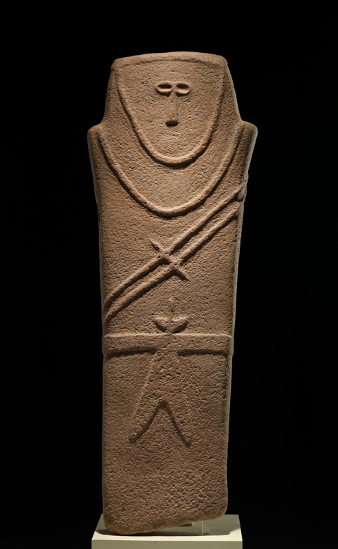 This 6,000-year-old anthropomorphic stele, which most likely served religious or burial functions, is one of three that stands at the entrance to the Roads of Arabia exhibit. (credit: Courtesy of the Carnegie Museum of Natural History, the Smithsonian's Museums of Asia)