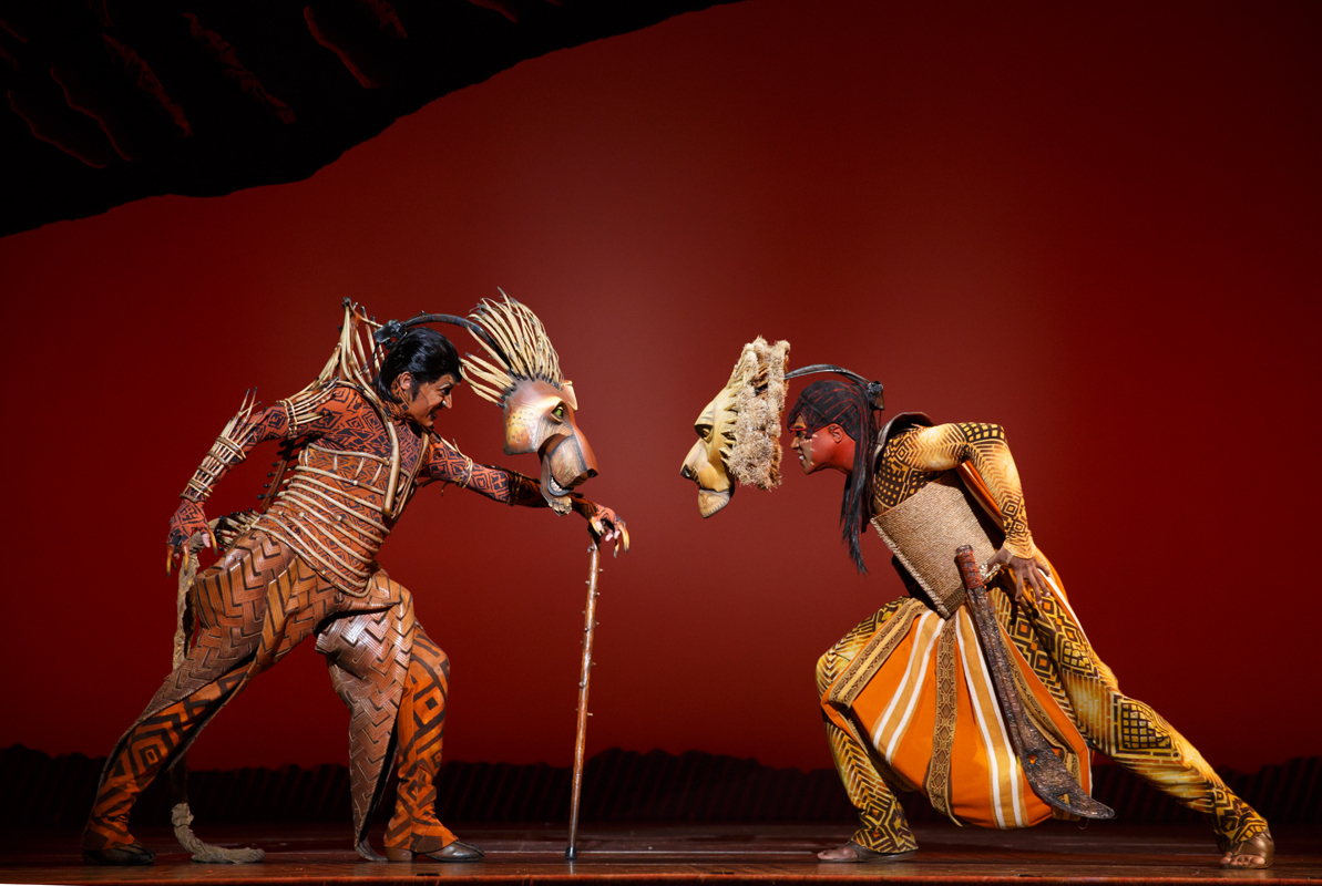 Scar (left, played by Patrick R. Brown) and Mufasa (right, L. Steven Taylor) face off in the Broadway Across America production of The Lion King. (credit: Courtesy of Joan Marcus)