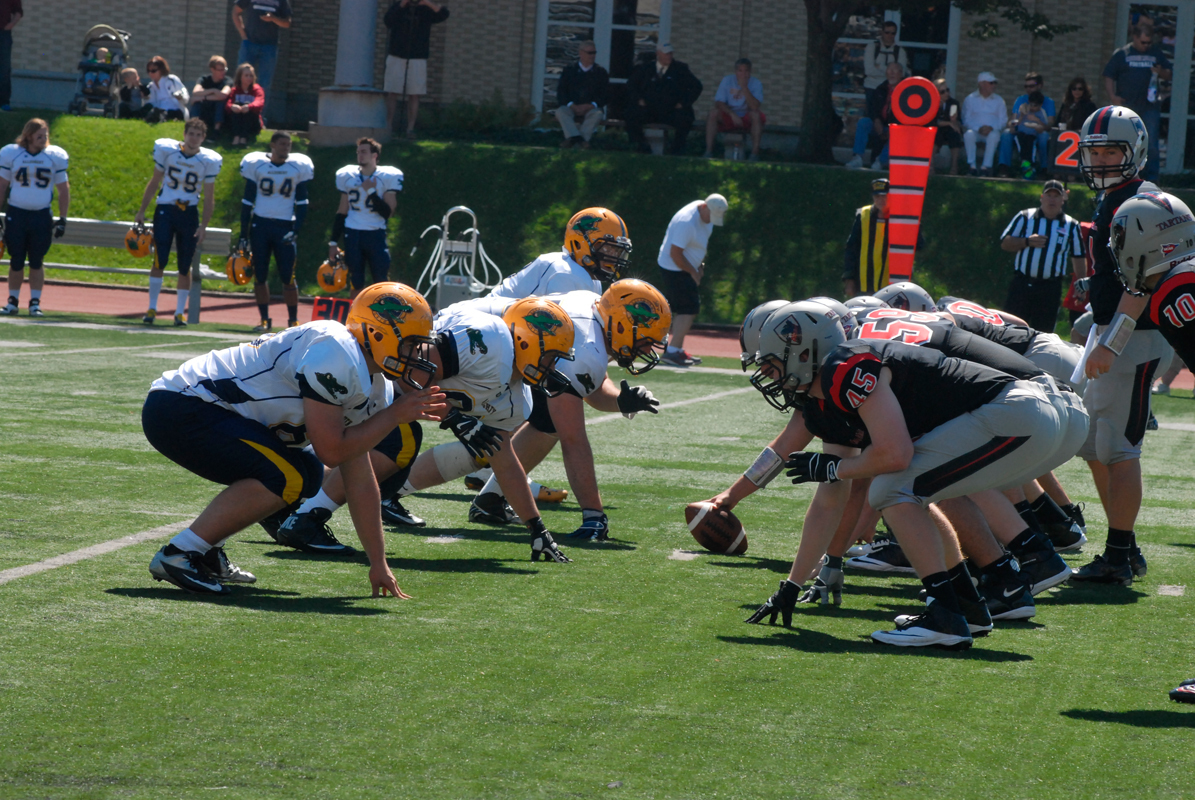 The Tartan offensive line prepares for the snap against Allegheny College at Gesling Stadium on Saturday. (credit: Kelsey Scott/Operations Manager)